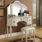 amazing white vanity design with arched mirror design and carved storage and stool on patterned area rug