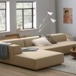 apartment sectional sofas in modern design with chaise featuring standing floor lamp and wooden coffee table plus decorative patterned rug for comfy living room