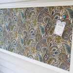 appealing handmade decorative magnetic board with stunning patterned fabric plus wooden framed mounted on the wall