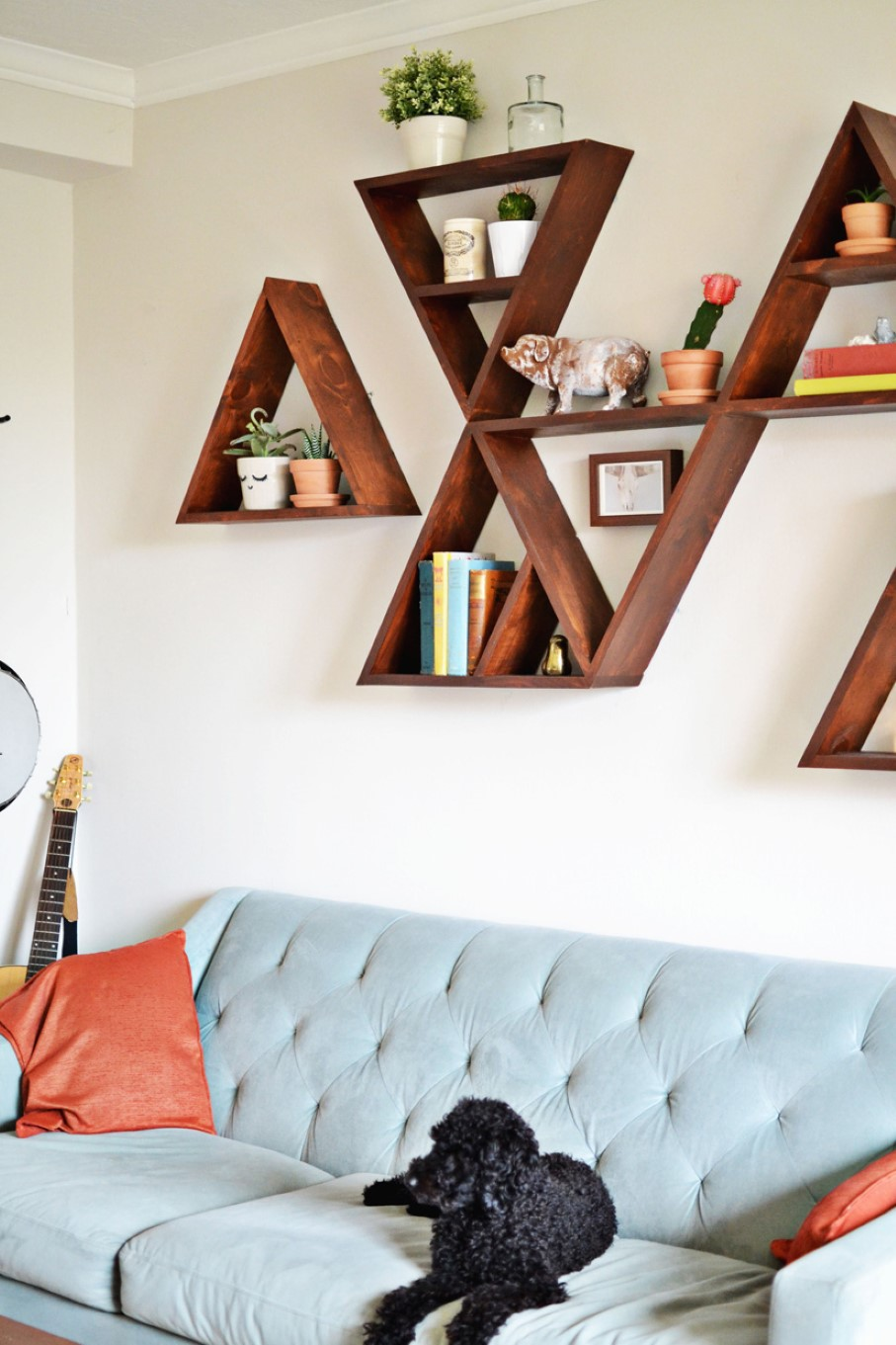 Artistic Wooden Diy Wall Shelves Idea In Letter Shape Above Soft Blue  Tufted Sofa With Sectional