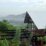 astonishing wooden house idea with zink roof and black iron frame and large balcony