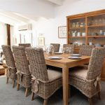 awesome dining room seat cushions on rattan chairs adorned with ribbon together with wooden cabinets with glass doors plus gray rug area