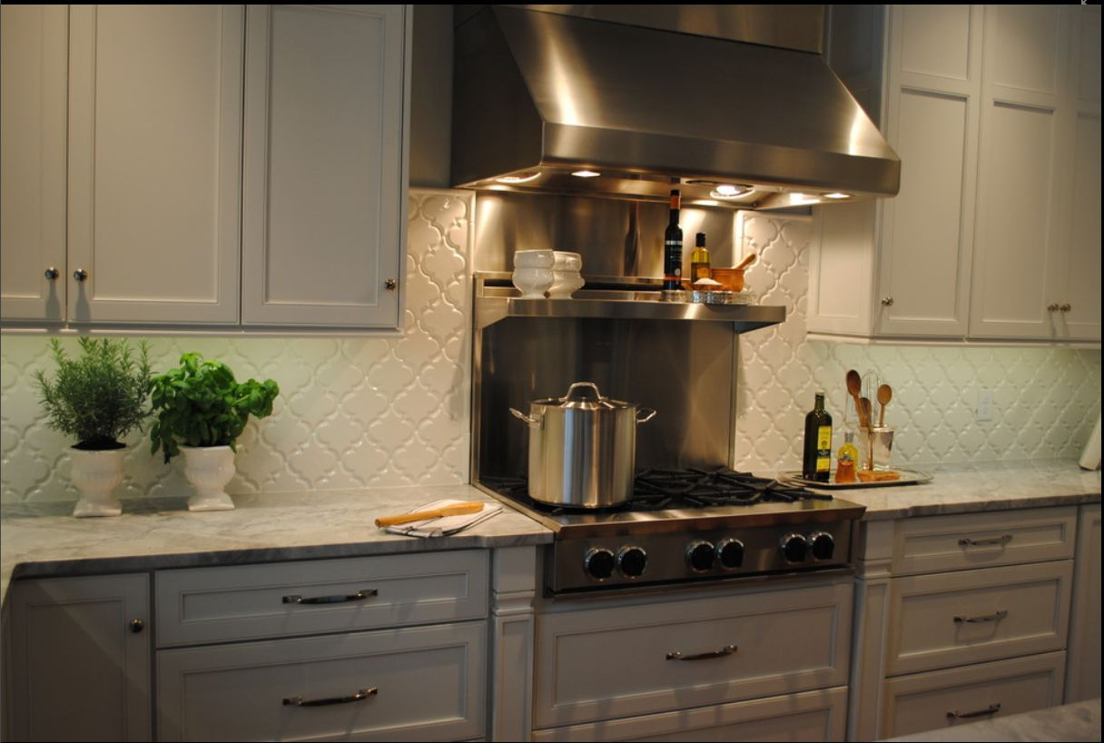 awesome kitchen decoration with beveled arabesque tile backsplash together with wooden kitchen cabinets and fresh greenery and steel kitchen appliance