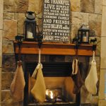 awesome rustic mantel decor with unique candleholders plus socks and pictures for woderful home ideas