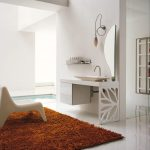 bathroom with contemporary rug in brown color with small chair on white glossy floor before luxurious vanity with unique wall mirror