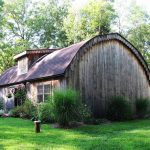 beaverbrook quonset hut homes made of wood with glass windows and appealing garden ideas