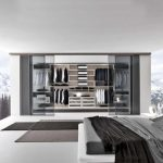 bedroom design with open concept and large floor to ceiling windor and walk in wardrobe design with mountain view