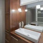 Best Design Of Wooden Cabinetry With Modern White Sink And Pendants And Wall Mirror And Linen Tower