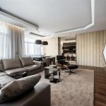 best interior design with glass window and wooden floor and geometrical wall texture and gray sofa and suspended ceiling