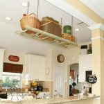 best kitchen design idea with creamy painted wall and hanging ladder storage above the island with rattan baskets