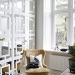 best scandinavian interior decor with yellowish chair before desk with black and white striped area rug and glass window