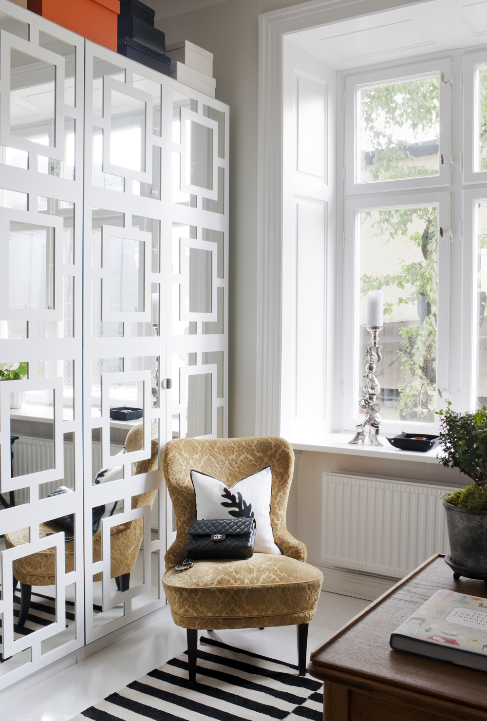 Best scandinavian interior decor with yellowish chair before desk with black and white striped area rug