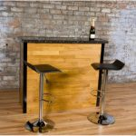 best small and simple home bar ikea design with black modern stools and tan bar table on wooden floor with rustic brick wall