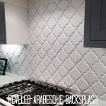 beveled arabesque tile backsplash installation giving beautiful kitchen nuance together with marble countertop and photo frames on it