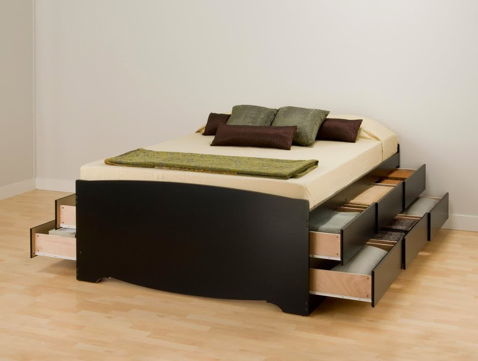 black wood bed frame with a groups of drawers and without headboard