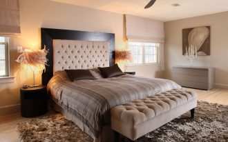 breathtaking bedroom with tufted headboard and fabric tufted bed ottoman bench and comfy bedframe and beautiful area rug featuring round wooden nightstand