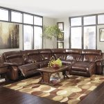 brown leather sectional sofa clearance in comfortable design with chaise in one side together with patterned rug and wooden coffee table plus traditional end table