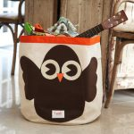 brown-owl-storage-bin-by-3-sprouts-with-orange-line-for-toys-and-stuffs-placed-near-wooden-chairs-and-table