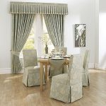 charming slipcovers for dining room chairs with patterned fabrics combined with impressive window treatmet in the same pattern with the chairs plus wooden floor