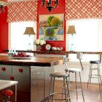 cheerful red kitchen design with stainless steel cabinet and red curtain blind and wooden floor and stools for bar