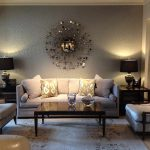 Classic Living Room Interior Design With White Sectional Couh Ide And Black Wooden Coffee Table And Unique Wall Decor And Lighting