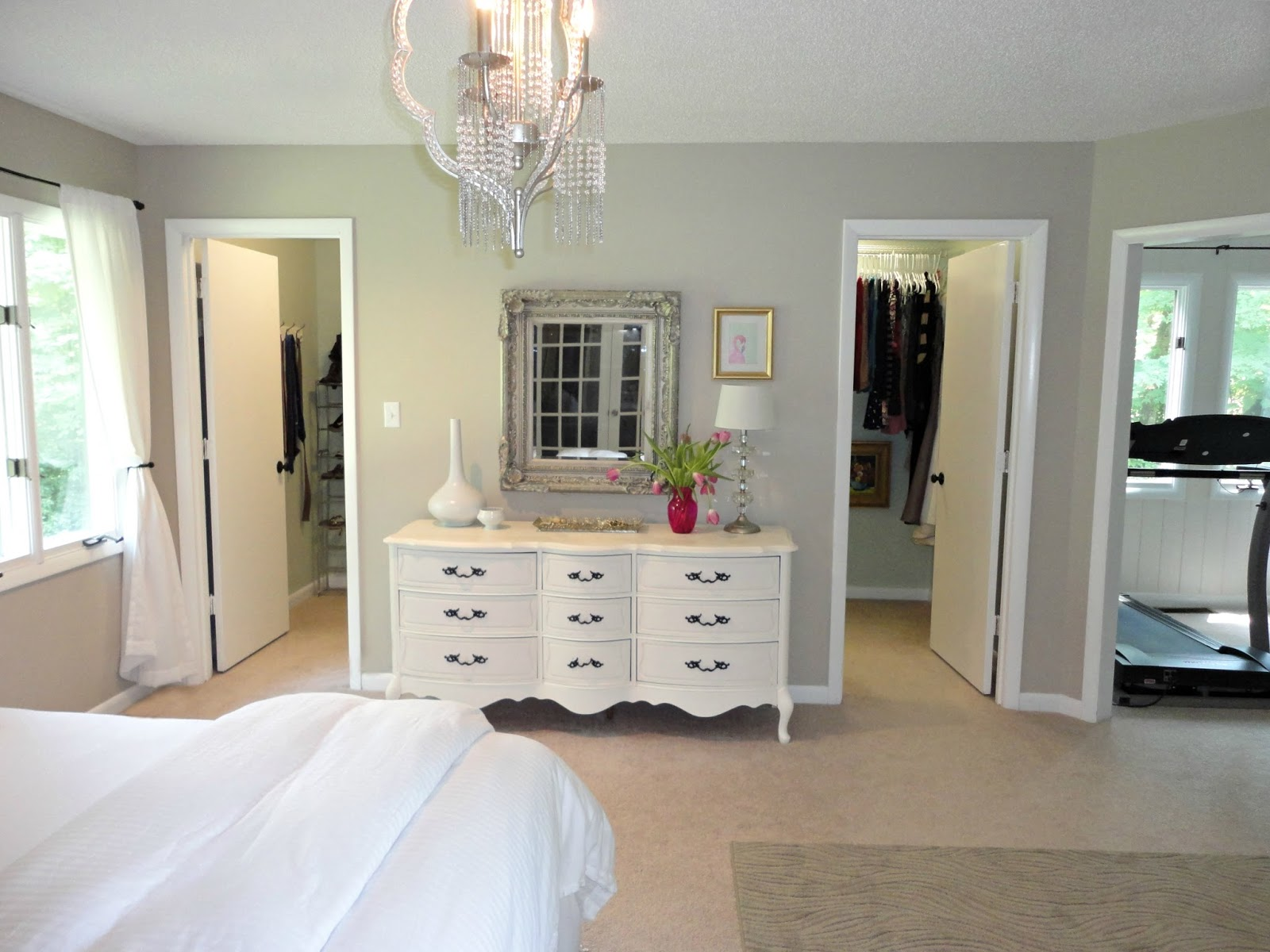 Classic Master Bedroom Design With Walk In Closet And White Vintage Vanity Wall Mirror