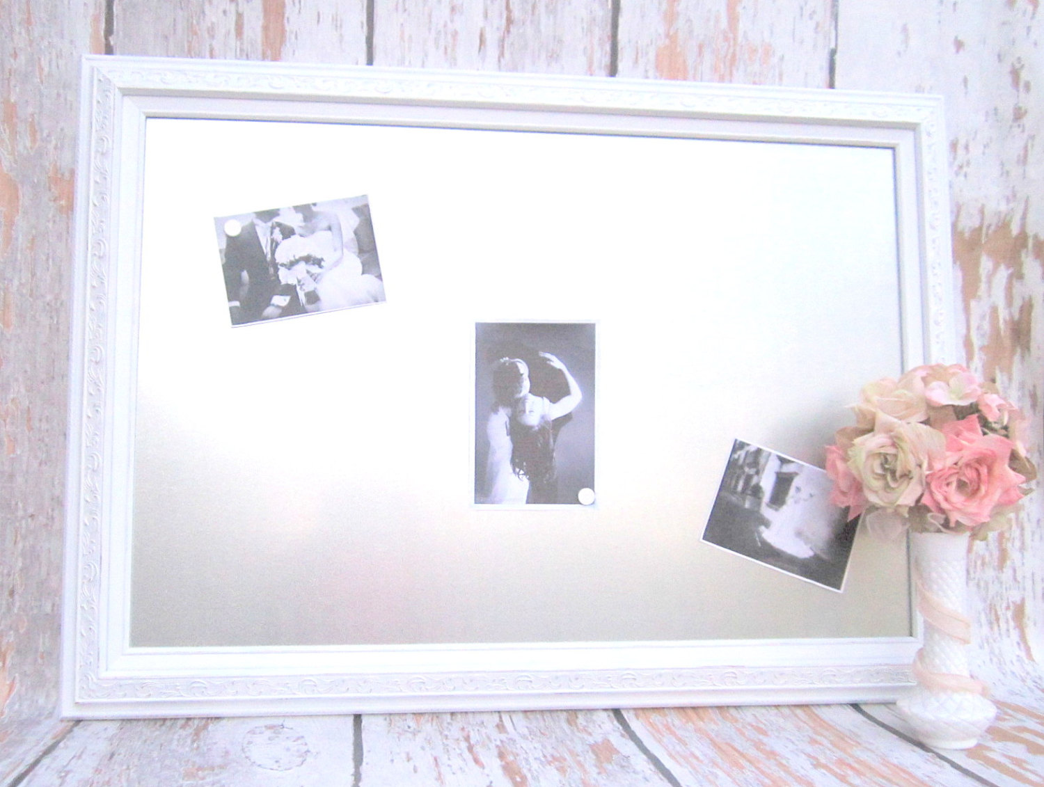 Classy decorative magnetic board for photos and memos together with attractive flower vase