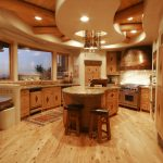 classy wooden small kitchen design with curved ceiling idea and supended style with wooden floor and wooden cbainet