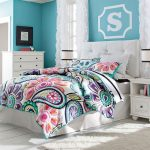 colorful bedroom design with boho chic comforter idea and blue wall paint and tufted simple headboard