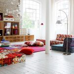 colorful floor seating idea with floral pattern in various shape with curved floor lamp and wooden storage