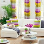 colorful interior design with rainbow curtain idea with spring mood idea with white couch idea and brown flooring and orchid decoration