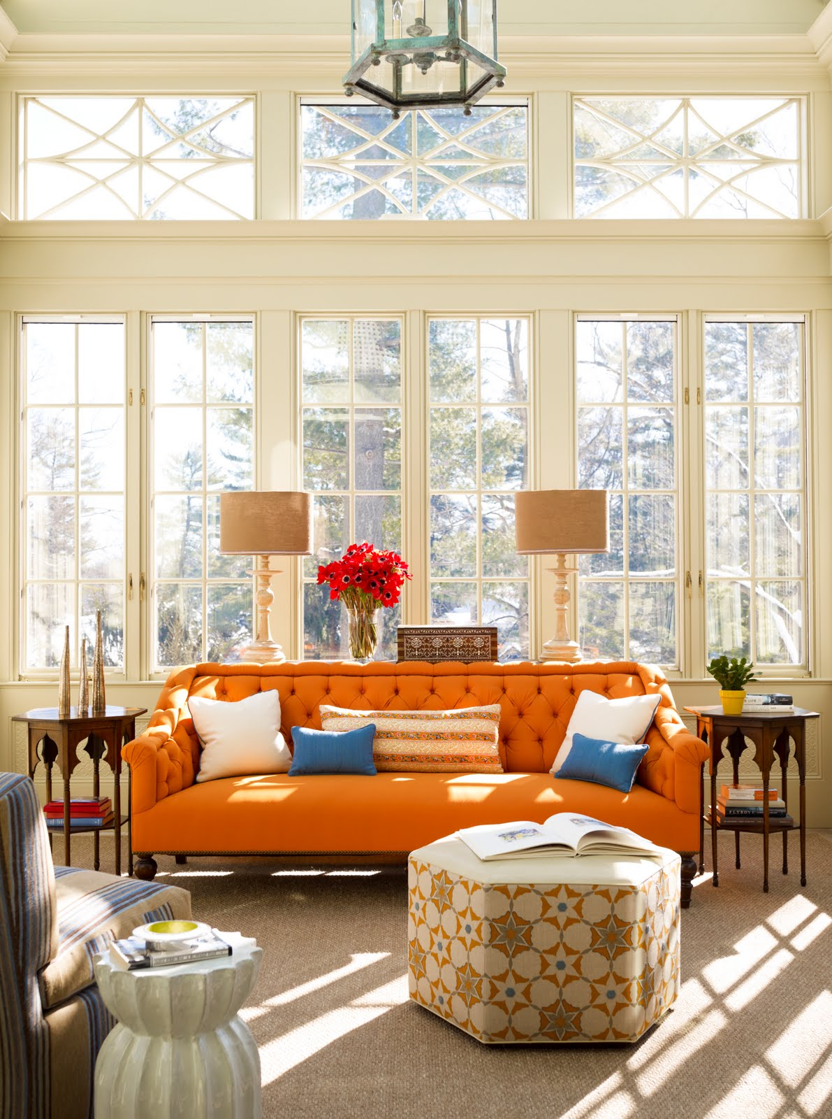 Comfortable Orange Chesterfield Sofa Design With Hexagonal Patterned Coffee  Table And Lamps And Chandelier And Glass Part 70