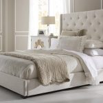 contemporary ivory tall upholstered bed with sophisticated tufted headboard together with soft bed linen