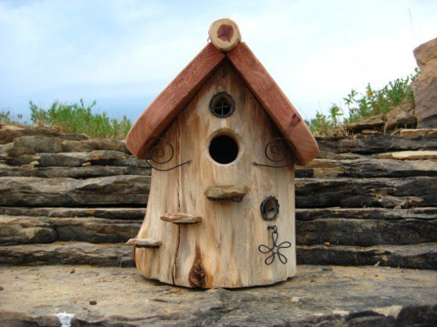 creative-and-decorative-Bird-House-Handmade-From-Wood-for-outdoor-and-made-from-Hollowed-Cedar-Log