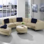 Curved Shaped Sofa Or Most Comfortable Sectional Sofa With Ivory Upholstery And Round Ottoman For Coffee Table For Elegant Living Room Ideas