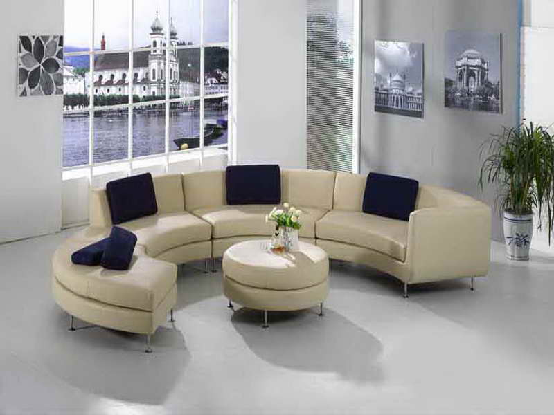 most comfortable living room furniture. curved shaped sofa or Most comfortable sectional with ivory upholstery  and round ottoman for coffee luxurious living room Comfortable Sectional Sofa Fulfilling a Pleasant