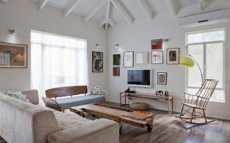 eclectic interior design in white color with wooden floor and creamy velvet sofa design and wooden coffee table and wall photo frame