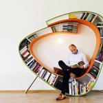 elegant and furturistic cool bookshelves design in green and orange color combination on wooden floor
