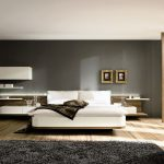 elegant bedroom design with gray siding and wooden pole and black furry rug and wooden floor and floating shelves