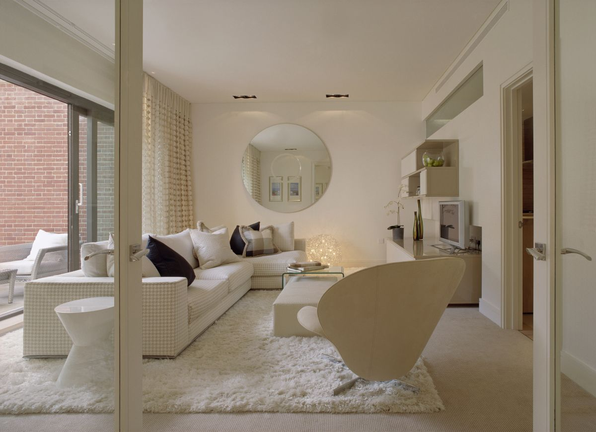 Complete your interior with posh treatment of faux fluffy Modern white living room decor