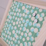 elegant decorative magnetic board with wooden frame and polka green fabric for background for memo and picture frame