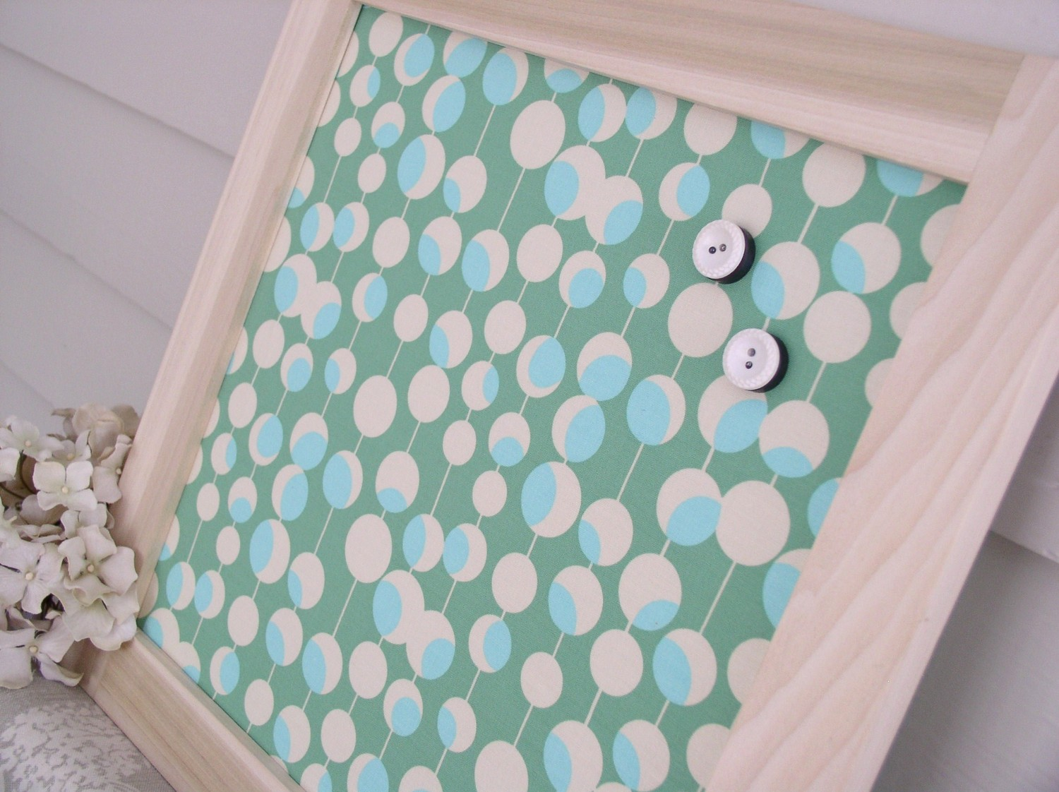 Elegant decorative magnetic board with wooden frame and polka green fabric for background for memo and