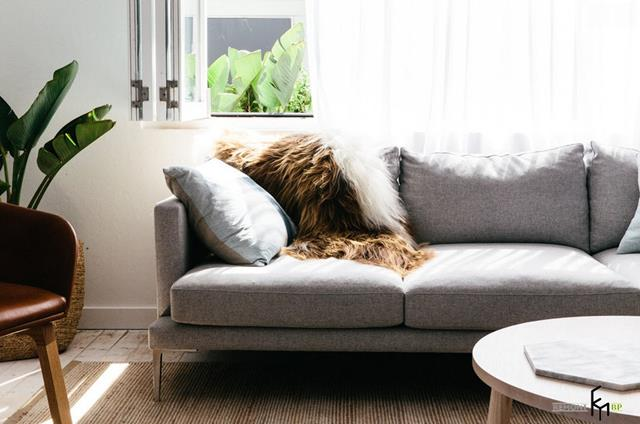 http://homesfeed.com/wp-content/uploads/2015/12/elegant-gray-apartment-sectional-sofa-idea-design-with-faux-furry-throw-and-cushion-and-round-white-coffee-table-and-wooden-floor.jpg