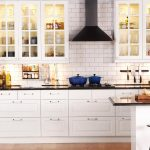 elegant white kitchen cabinet planner idea design with brick white backsplash and wooden stool and white island with black top