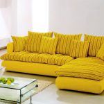 elegant yellow couch design with stripe pattern and loveseat and glass rectangle coffee table and area rug