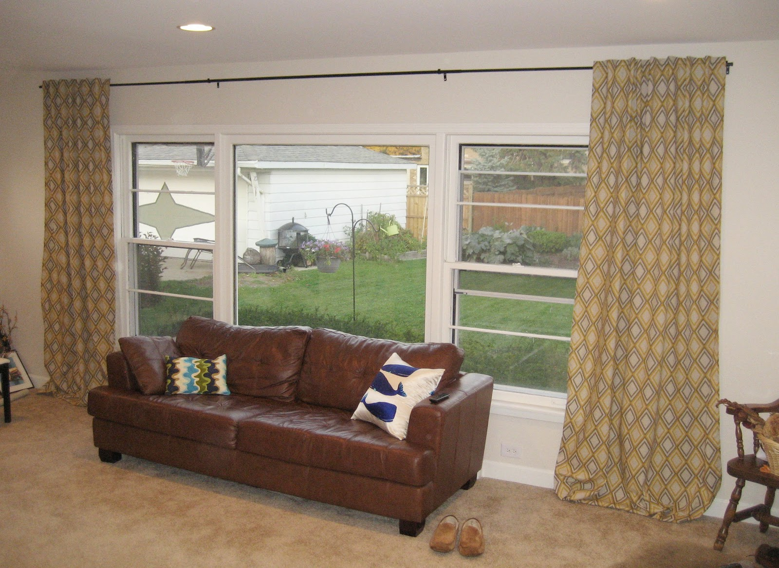 Extra Long Curtain Rods With Brown Leather Sofa Plus Beige Area Rug For Stunning Family Room