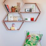 Fashionable Honeycomb Diy Wall Shelves Design With Small White Chair With Green Patterned Cushion And White Painted Wall
