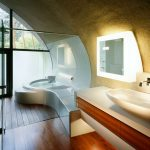 girgeous unique japanese bathroom design with curving ceiling and wooden floor and unique bathtub and floating vanity