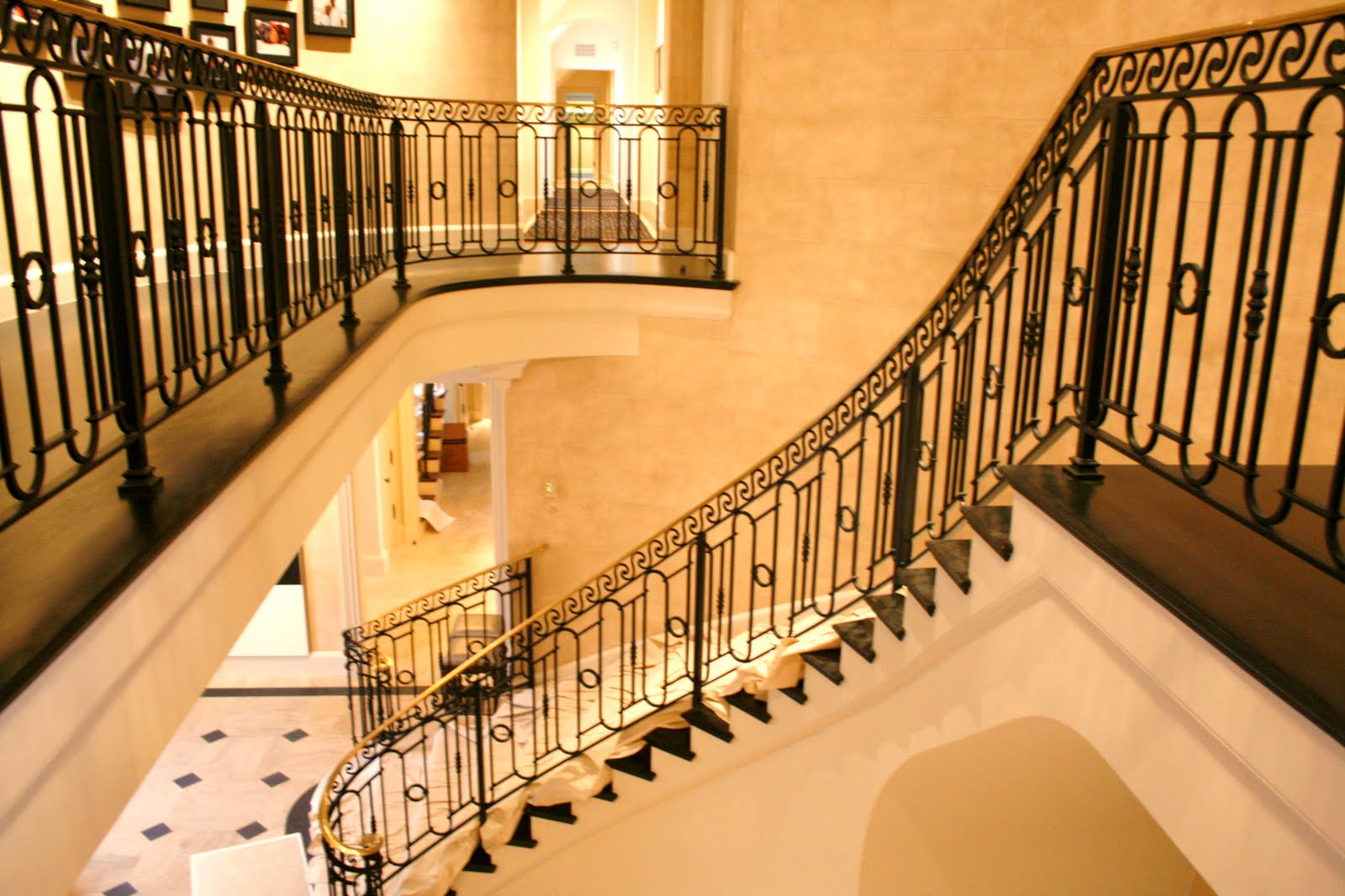 Wrought iron stair railings for creating awesome looking for Interior staircase designs