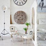 Goregous White Apartment Interior With Bohemian Decoration On Round Wooden Wall Ornament And The Clock Target And White Chairs And Indoor Plant